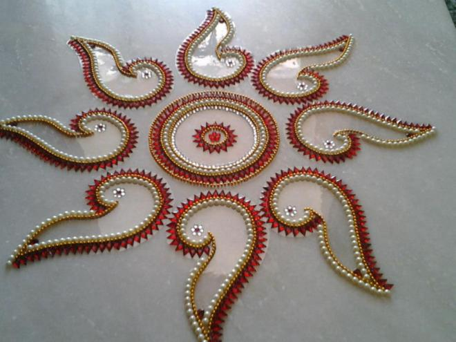 2 kundan rangoli design by neeta