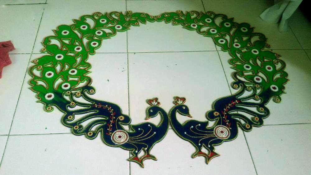 peacocks wooden rangoli design