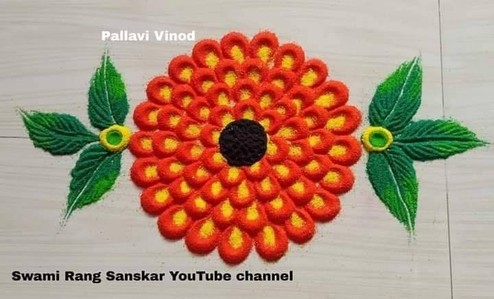 rangoli design orange flower pallavi vinod