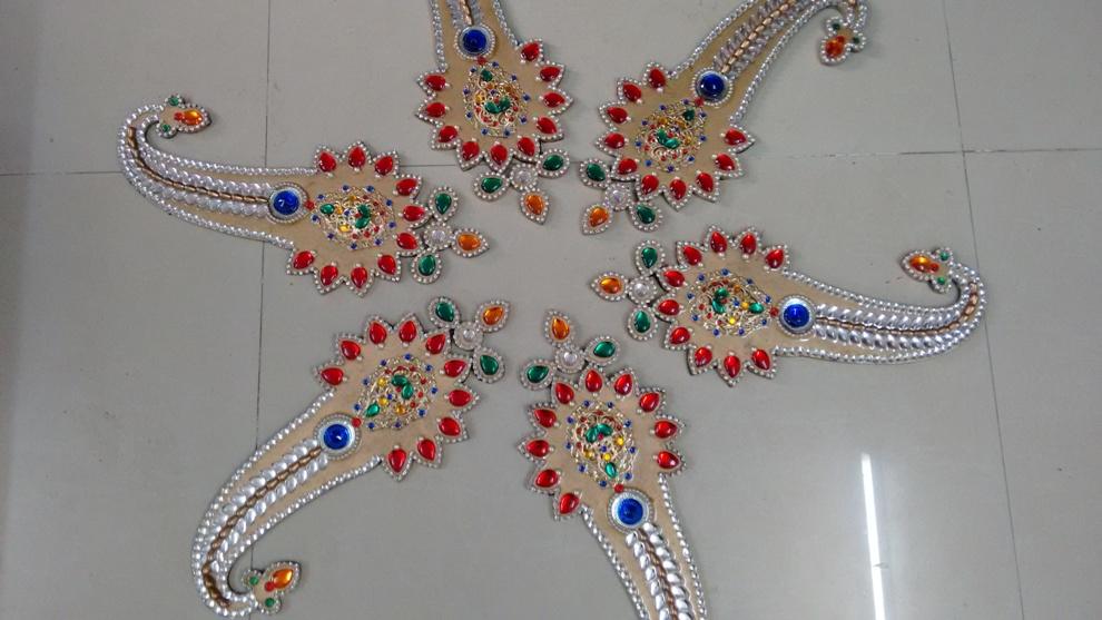 11 kundan rangoli design by neeta