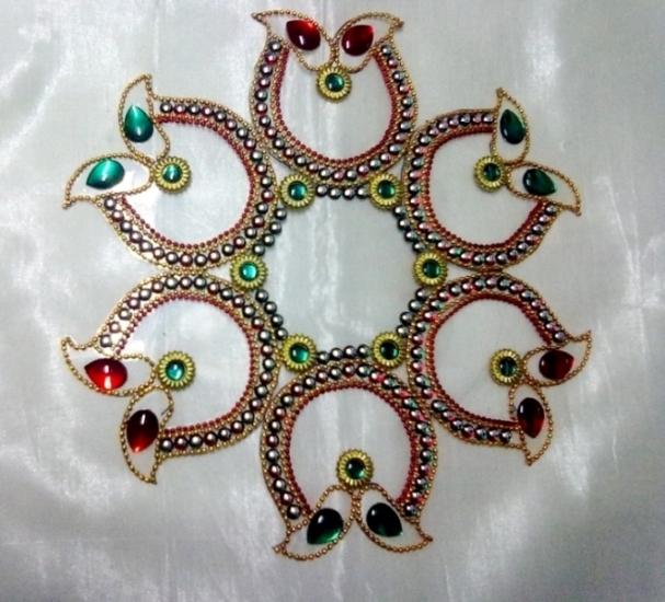 12 kundan rangoli design by neeta