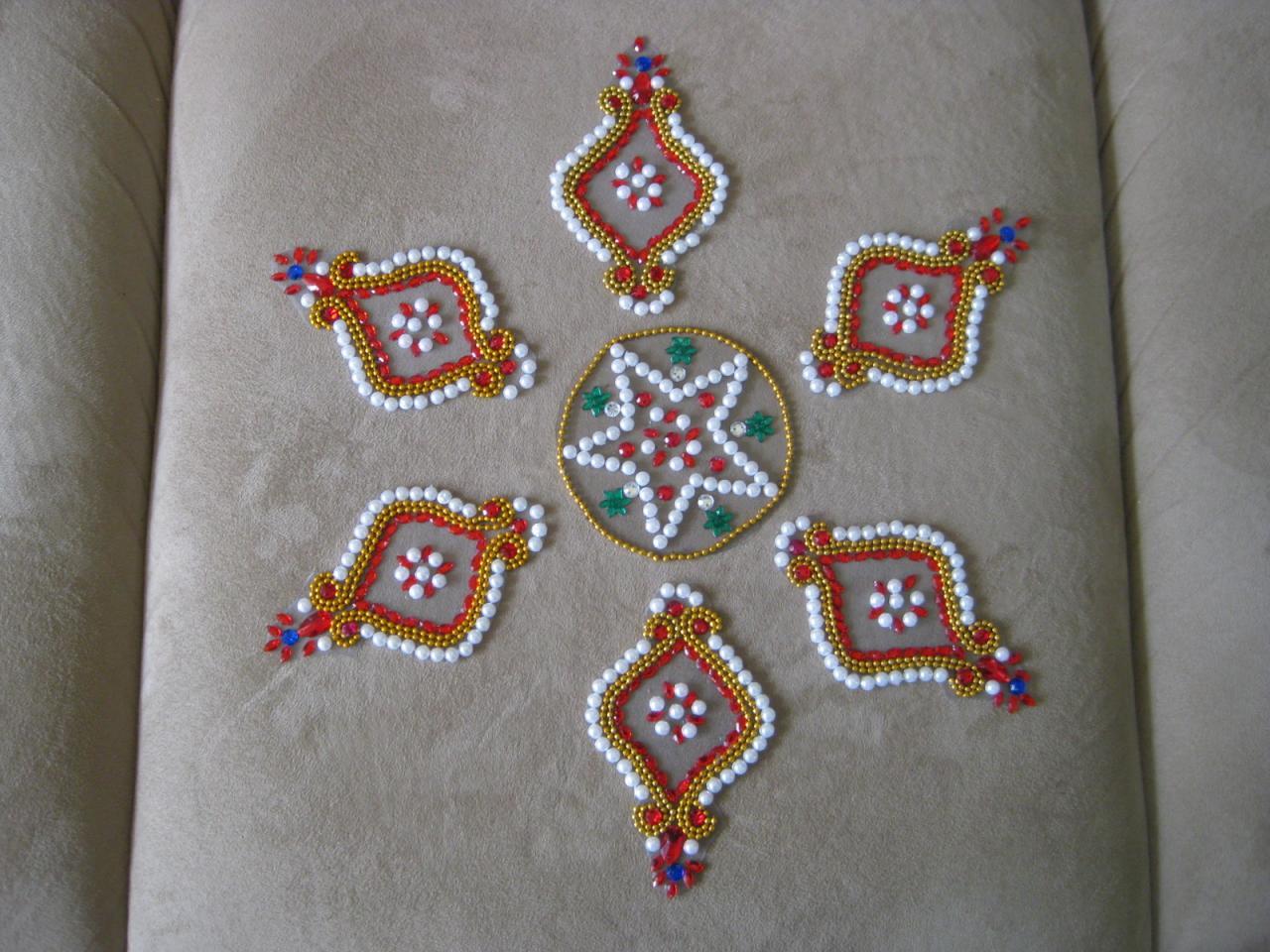 15 kundan rangoli design by neeta