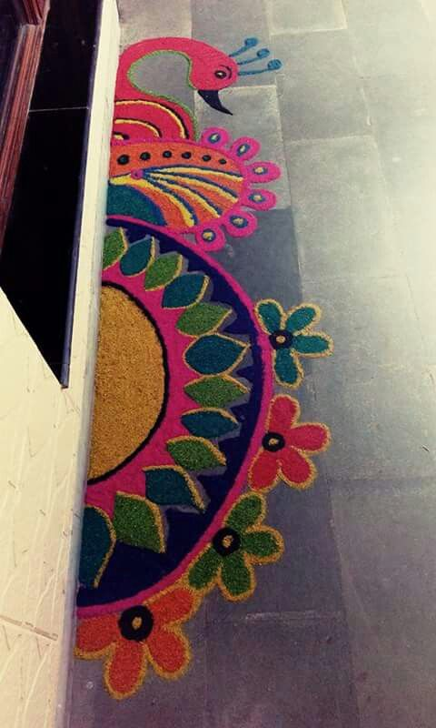 4 border peacock rangoli design by shilpa gohil