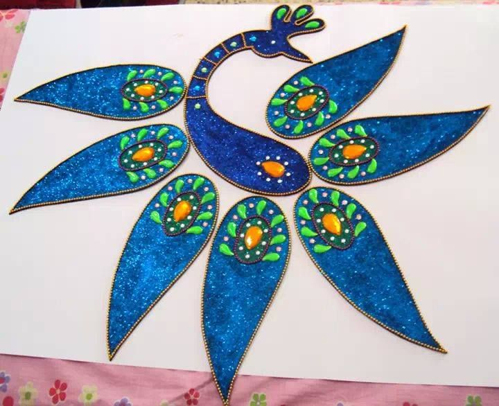 6 peacock kundan rangoli design by neeta