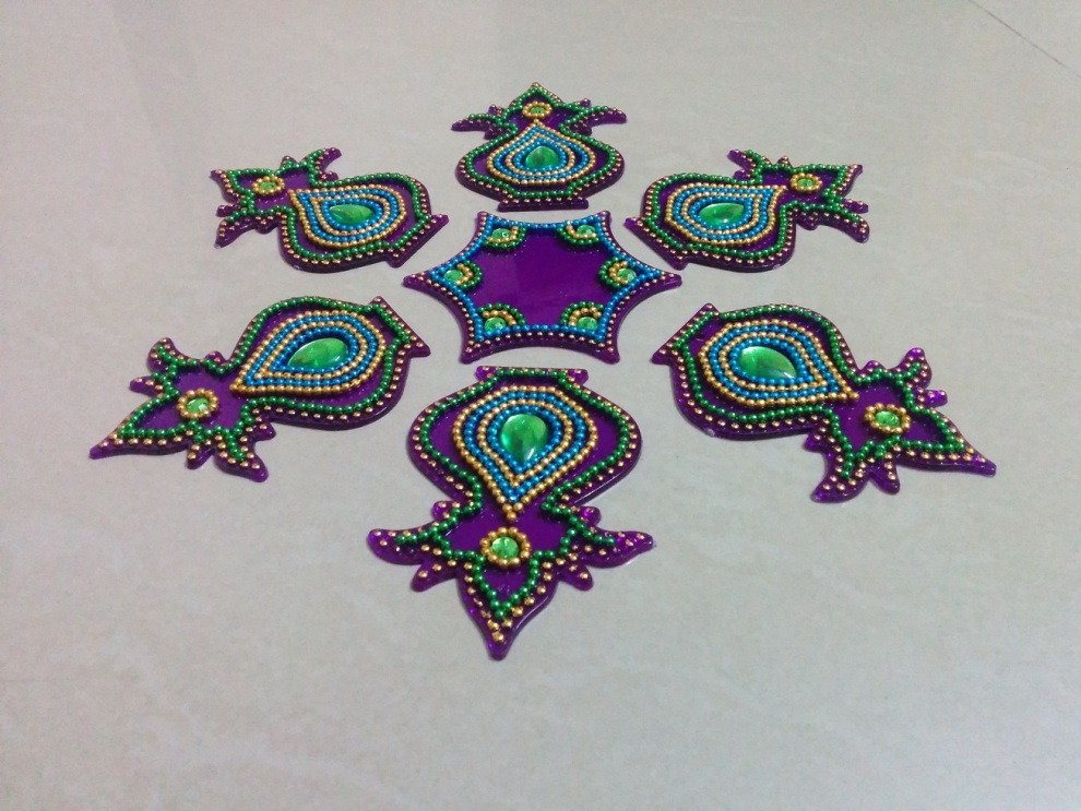 9 kundan rangoli design by neeta