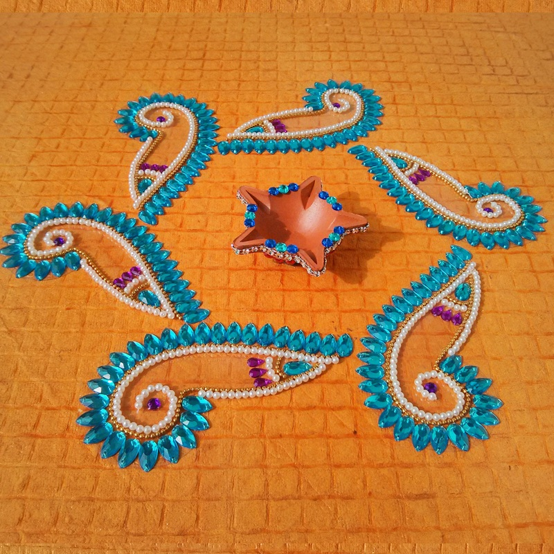 8 kundan rangoli design by padma