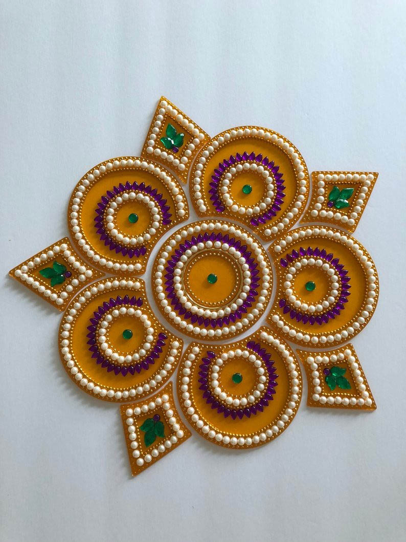 kundan rangoli design circles triangles