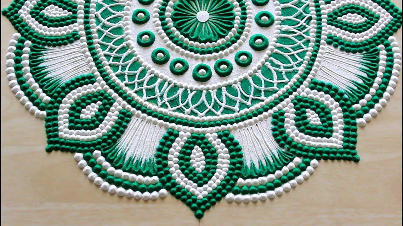 green floral rangoli design for pooja