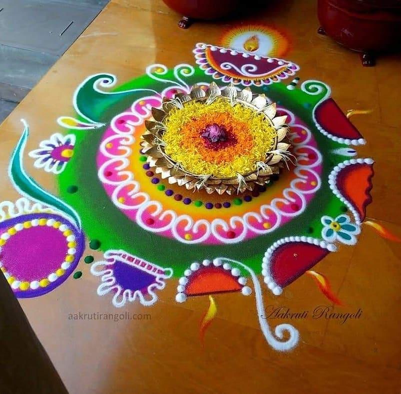 rangoli design diya by aakruti