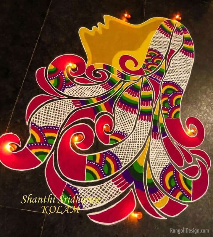 rangoli design freehand woman by shanthi sridharan